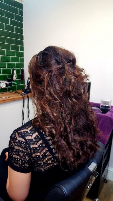 Highlights with a wavy, twisty blow dry