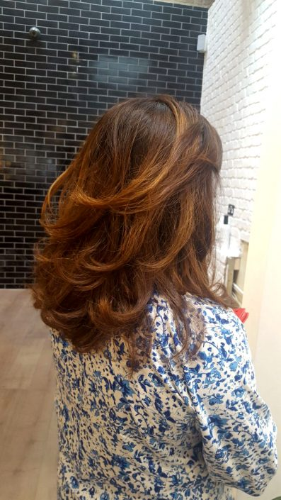 Cut, colour and highlights with a relaxed wavy blow dry