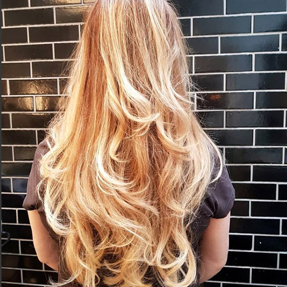 Blonde highlights with a wavy natural blow dry